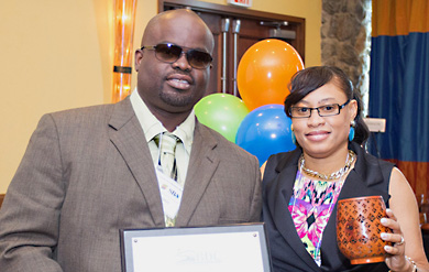 Just Threads owners Cyril and Germene Thomas pose for a photo after their business was named the Small Business of the Year on St. Thomas.