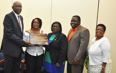 UVI President Dr. David Hall presents the President's Appreciation Award to the Voices of Inspiration Community Choir at the June 2013 Board of Trustees meeting.