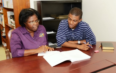 Dr. Valerie Combie Assists a Student at the Writing Center