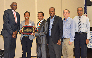 UVI President David Hall presents the President's Appreciation Award to Provost Camille McKayle, Dr. James Maddirala, Henville Pole, Stuart Ketcham and Dr. Frank Mills.
