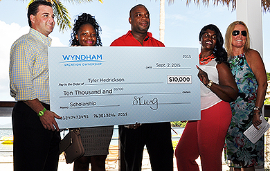 Bryan Dixon, director of Resort Operations for the Caribbean Region, UVI student Tyler Hendrickson and  her parents, and Sarah King, executive vice president of Human Resources for Wyndham, pose for a photo after a scholarship presentation at Wyndham Margaritaville.