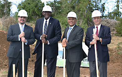 Victor Santiago, of FirstBank, UVI President David Hall, Angel Dawson, senior vice president of FirstBank and SOM Dean Dr Ben Sachs