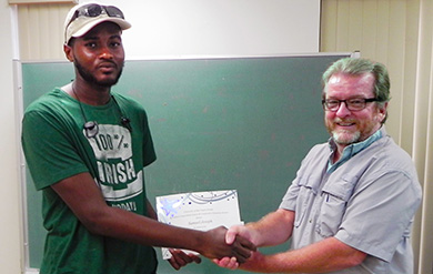 UVI Student Samuel Joseph and Bob Godfrey of the Agricultural Experiment Station