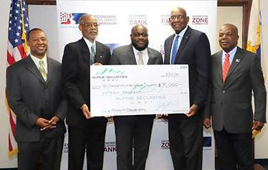 UVI Vice President of Institutional Advancement Mitchell Neaves, EDA Chairman of the Board Jose Penn, Chief of External Affairs at Alpine Securities Jason Charles, UVI President David Hall and EDA Director of Administration and Finance Ernest Halliday pose for photo at a check presentation held at the EDAs Nisky Center Offices
