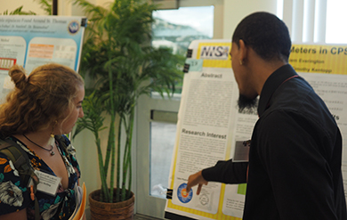Students view and discuss Research work at the Science Symposium