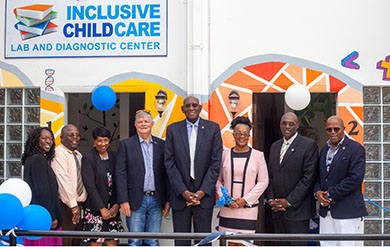 D. Karen Brown, Avery Lewis, Dr. Linda Thomas, Board Chairman Henry Smock, UVI President David Hall, Childcare Diagnostic Center Director Sherryl Tonge George, Senate President Novelle Francis and Sen Myron Jackson pose for photos in front of the Inclusive Childcare Laboratory and Diagnostic Center