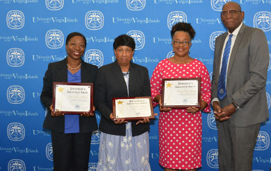 Dr Karen Brown, Dr Linda Smith and Sherryl Tonge George accept a Presidential Appreciation Award from UVI President David Hall