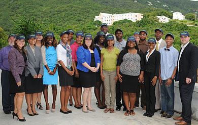 Photo of Wyndham execs presenting check to UVI